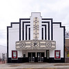 """Palmetto Theatre<br /> <br /> The Palmetto Theatre, built in 1946, is significant as an intact example of a small-town, southern, post-war movie theater whose Art Deco-influenced Art Moderne architecture reflects the social, economic, and aesthetic pressures of the period, as well as the immediate post-war transition between these two related architectural styles. Its continued use as a movie theater and live performance space to the present day, and the high degree of architectural integrity it retains, make the Palmetto Theatre highly significant at the local level. The Palmetto Theatre was the brainchild of owners T. G. """"Mutt"""" Stanley, a one-time mayor pro tem of Hampton, and Dr. James A. Hayne, Jr., a local physician. Design and construction of the building is attributed to Clarence L. Freeman of nearby Varnville. Based in part on the Carolina Theatre in Allendale, South Carolina, the design of the Palmetto features a prominent, ornate, projecting marquee and upper central pylon with highly stylized neon lettering and geometric patterns set against inset black pigmented structural glass panels. Built at a cost of $45,000, the theater was designed to seat 450 people, including balcony seats, and included upholstered, cushioned chairs with a red, white, and blue color scheme for the interior. Original projection equipment included RCA-Brenkert 35mm projectors with high intensity arc lamps. A soda shop located in an adjacent building, later known as the """"Theatre Soda Shop,"""" offered """"complete fountain service, sandwiches, and soups,"""" whether for """"breakfast, dinner, or supper."""" The Palmetto Theatre remains as one of only a small handful of Art Moderne theaters in the state of South Carolina. Listed in the National Register October 9, 2012."""