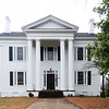 William Dunlap Simpson House<br /> <br /> Constructed in 1839, this Greek Revival dwelling has been owned by South Carolinians of prominence in both local and statewide affairs. The Simpson House is an excellent example of Greek Revival architecture. Its designer-owner, Christopher Garlington, probably with the aid of a pattern book, created a structure that still retains the aura of an antebellum plantation house owned by a wealthy planter. The white clapboard structure has three stories with a total of twelve rooms. The gable roof is pierced by four end chimneys contained within the structure. A fifth chimney is in the rear projection. At the end of the Civil War William Dunlap Simpson purchased the house from John Adam Eichelberger, a wealthy planter who had used the structure as his townhouse. Simpson, a graduate of South Carolina College and Harvard Law School, had been a member of the South Carolina House of Representatives for several terms and was a member of the State Senate when South Carolina seceded. During the Civil War, he reached the rank of Lieutenant Colonel. After the war he was elected to the US House of Representatives; however, due to his Confederate affiliations, he was refused his seat in the House. Wade Hampton was elected governor in 1876 with Simpson as lieutenant governor. When Hampton was elected to the US Senate in 1879, Simpson became governor. He was appointed Chief Justice of the South Carolina Supreme Court in 1880. The Motes family purchased it from Simpson heirs in 1939. The once elaborate gardens, orchard, and vineyard have disappeared. Listed in the National Register July 24, 1974.