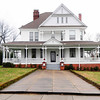 Lyde Irby Darlington House<br /> <br /> The Lyde Irby Darlington House is architecturally significant in the city of Laurens as an eclectic, turn of the century residence. Built ca. 1899, the house is an important architectural document of the period when the exuberant Eastlake and Queen Anne styles were losing popularity to the more restrained and sedate Classical Revival styles. The house utilizes elements of each of these styles in its plan and ornamentation. Exterior features of the Queen Anne style include polygonal bays, a wraparound porch, sheathing of weatherboarding and alternate shingles in the gable. Eastlake ornamentation includes the perforated brackets, turned posts, balustrades, and friezes found on the porch and balcony. The Classical Revival style is represented in the pedimented gables of the house and porch. Three brick chimneys pierce the roof. Interior features include pocket doors, plaster walls, wainscoting, mantels with beveled glass mirrors, coal grates with tile surrounds, and a built-in china cabinet. The house was built as a residence for Col. Thomas Dean Darlington (1867-1932) and his wife, the former Lyde Irby (1873-1934). The Lyde Irby Darlington House is located on a large lot in a quiet, residential neighborhood of the city of Laurens. A molded cement block retaining wall surrounds the front yard and lines the wide front walk. Listed in the National Register November 19, 1986.