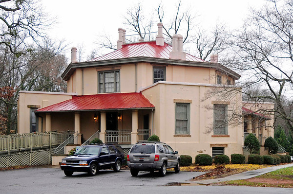 Octagon House<br /> <br /> (Holmes-Watson House) The Octagon House, constructed in 1859, is considered to be the first concrete house built is South Carolina. This eight-sided structure with hipped roof has four porches and four extended rooms on the first floor level and a central octagonal core for the second-floor level. The octagonal design is maintained throughout, even down to the eight-sided porch columns and chimneys. Window design and placement varies in each façade, but all have granite sills and lintels. A large square skylight that illuminates the interior central hall of both floors crowns the upper roof. The octagonal motif that is so prominent on the exterior is muted inside the house. Below the first floor are basement rooms with outside access only. Most of these rooms were originally used as domestic slave quarters, but one small one built entirely of field stone served as an ice house and collection point for moisture which accumulated in the concrete walls and was transferred to this location by a series of drain pipes. While the house displays several interesting architectural features, it is primarily significant as an early appearance of the method of construction utilized by the designer and builder, Zelotes Lee Holmes, a Presbyterian minister and educator of upcountry South Carolina. The walls are from 12 to 15 inches thick and include hollow passages that provide a cooling ventilation system throughout the house. As one of the first concrete houses in South Carolina, the Octagon House stands as a landmark to a structural technique that did not fully mature in the state until the twentieth century. Listed in the National Register March 20, 1973.