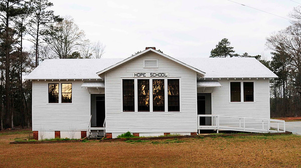 Hope Rosenwald School<br /> <br /> The Hope Rosenwald School is significant for its role in African-American education and social history in South Carolina between 1925 and 1954, and as a property that embodies the distinctive features of a significant architectural type and method of schoolhouse construction popular throughout the southern United States in the early twentieth century. Like other Rosenwald schools, the Hope Rosenwald School can trace its origins to the contentious debate over the education of southern African-Americans in the late nineteenth and early twentieth centuries. While the end of the American Civil War had brought about state-initiated funding and operation of some local schools for black children in the South, the policies emphasizing racial segregation during the Jim Crow era left southern blacks with few opportunities for a truly complete primary education and even fewer secondary school options. Among those who sought a method for insuring that black educational opportunities in the South might be improved was Julius Rosenwald, CEO of Sears & Roebuck and a trustee of the Tuskegee Normal and Industrial Institute. At the request of Booker T. Washington, Rosenwald began a school building fund to benefit southern African-Americans, especially those in rural regions, and from 1917 to 1932, Rosenwald's program led to the construction of more than 5300 public schools, teachers' homes, and instructional shops in fifteen southern states, nearly 500 of which were located in South Carolina. Listed in the National Register October 3, 2007.