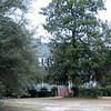 Numertia Plantation<br /> <br /> The house at Numertia is believed to have been constructed ca. 1850-51 by Major Samuel Porcher for his grandson Richard Shackelford Porcher, a young planter. It is one of the few plantation houses associated with the antebellum cotton planters of the middle and upper sections of (what was formerly) St. John's Parish, Berkeley, Charleston District, that remained intact on its original site after the flooding of two large areas of the parish by the Santee-Cooper hydroelectric project in the 1940s. Architecturally, Numertia is representative of the building technology and forms of the early and middle nineteenth century for rural South Carolina. The braced timber frame is composed of hewn and whip-sawn beams and posts with mortise and tenon joints, fitted with wooden pegs. Its central hall plan was ubiquitous in the Southeast among major and minor farmhouses. The gabled roof and the roof of the façade porch are sheathed in standing-seam metal. The basement is of brick. The house is in a remarkable state of preservation with most of the original materials and hardware intact. Noteworthy features are the English box locks, self-closing hinges, paneled wainscoting and a broad double-run staircase. Included in the nominated acreage are the original carriage house, smokehouse, and warehouse. Listed in the National Register March 19, 1982.