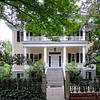 Caldwell-Hampton-Boylston House<br /> <br /> The Caldwell-Hampton-Boylston House is significant as one of Columbia's finest examples of Greek Revival architecture. The house is historically and politically significant because of its owners who were important in South Carolina affairs and its proximity and association with the Governor's Mansion. In 1869, the house was bought by Daniel H. Chamberlain, South Carolina Reconstruction governor, who resided there 1874-1876. It was also the home of John Caldwell, Columbia banker, and later the Frank Hampton (brother of General Wade Hampton) family. The significance of the gardens should also be noted. Planting had probably been done when the house was built ca. 1830 and added to throughout the last half of the nineteenth century. Mrs. Sarah Porter Smith of Chicago bought the house in 1895 for winter quarters and began further landscaping, featuring formal arrangements of boxwoods, grassy plots, shady arbors, walls and statuary with hundreds of azaleas, camellias and dogwoods, as well as rare shrubs and trees. During her and the subsequent ownership by her niece, Mrs. Sarah Porter Boylston, the gardens were a social gathering place and used for elaborate garden parties. The house is a three-story clapboard Greek Revival mansion with two matching inside chimneys. The double-tiered porches are supported by four columns and have a simple balustrade on each story. The house and gardens are surrounded by handsome ironwork and brick fencing (ca. 1855). Outbuildings include a stable/carriage house, garden gazebo, and tea house. Listed in the National Register May 6, 1971.