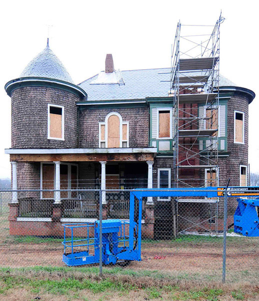 Bishop William Wallace Duncan House<br /> <br /> The Bishop William Wallace Duncan House, built ca. 1886, exemplifies the Queen Anne style of architecture. Duncan was a bishop of the Methodist Episcopal Church and was an active leader in the fields of education and religion. The house's design was produced by Gottfried L. Norrman, a well-known Swedish born, Danish and German trained architect who practiced in Spartanburg and Atlanta. Built upon a brick basement, the two-story building has clapboard and cedar shingle siding laid in staggered butts. Asymmetrical in design, it has a high-pitched roof of many angles which is pierced by six chimneys. Significant architectural details include a decorative mosaic tile front porch landing, five large chimneys, the front one featuring a terra cotta cartouche containing the Duncan family crest, a massive wood shingle-clad cylindrical tower, stained glass and Queen Anne block glass windows, and a host of interior details such as oak paneling, spindle friezes and screens, a massive stone chimneypiece in the central hall, decorative wood mantels with overmantels and a staircase. Listed in the National Register July 12, 1976. The Bishop William Wallace Duncan House was moved from its original location at 249 N. Church St. to its present location on 300 Howard St in November 1999. Additional documentation approved October 2, 2009.