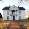 Reidville Academy Faculty House<br /> <br /> The Reidville Academy Faculty House is significant as an excellent example of mid-nineteenth century Greek Revival residential architecture with late-nineteenth century Victorian alterations. It is a two-story brick raised cottage with exterior brick walls covered with stucco and scored to look like large blocks of stone. One unusual feature of the house is that the east, or left, elevation has never been covered with stucco. The house is also significant for its association with the Reidville Male Academy and Reidville Female Academy, institutions that played a major role in education in upcountry South Carolina from 1858 to 1905. The academies were founded by Reverend Robert Hardin Reid (1821-1907), a Presbyterian clergyman and educator. The faculty house was built ca. 1860 as the residence for the principal of the Reidville Male High School. Both the male and female high schools remained open during the Civil War, and Reverend Reid persuaded Federal troops not to burn the schools when they camped briefly near Reidville at the end of the war in 1865. Listed in the National Register September 4, 1997.