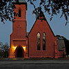 Church of the Holy Cross<br /> <br /> (Holy Cross Episcopal Church) Built in 1850, Holy Cross is of Gothic Revival design and is constructed of yellow pise de terre (rammed earth). Walls constructed of pise de terre (minimum depth of 13 inches) are almost impervious to earthquakes. Edward C. Jones of Charleston, designer of Holy Cross, was one of the best known South Carolina architects of the antebellum era. The cruciform Holy Cross is considered one of Jones's most unusual designs. It resembles an Old World Parish Church. The high-pitched roof is of red tile. The interior features Bohemian stained glass windows designed by Violett de Duc and a rare Henry Irwin organ. Holy Cross is significant in that it, along with various other structures in Stateburg, comprises the largest complex of pise de terre buildings in the United States. Buried in the graveyard of Holy Cross is Joel R. Poinsett, a U.S. Congressman, Minister to Mexico, Secretary of War, and first president of the forerunner of the Smithsonian Institution, who is best remembered for bringing the poinsettia flower to this country from Mexico. Listed in the National Register November 7, 1973; Designated a National Historic Landmark November 7, 1973.