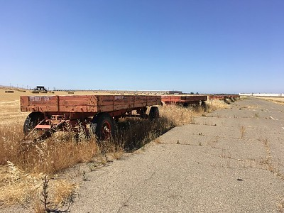 Farm equipment along west side of runway at Patterson.