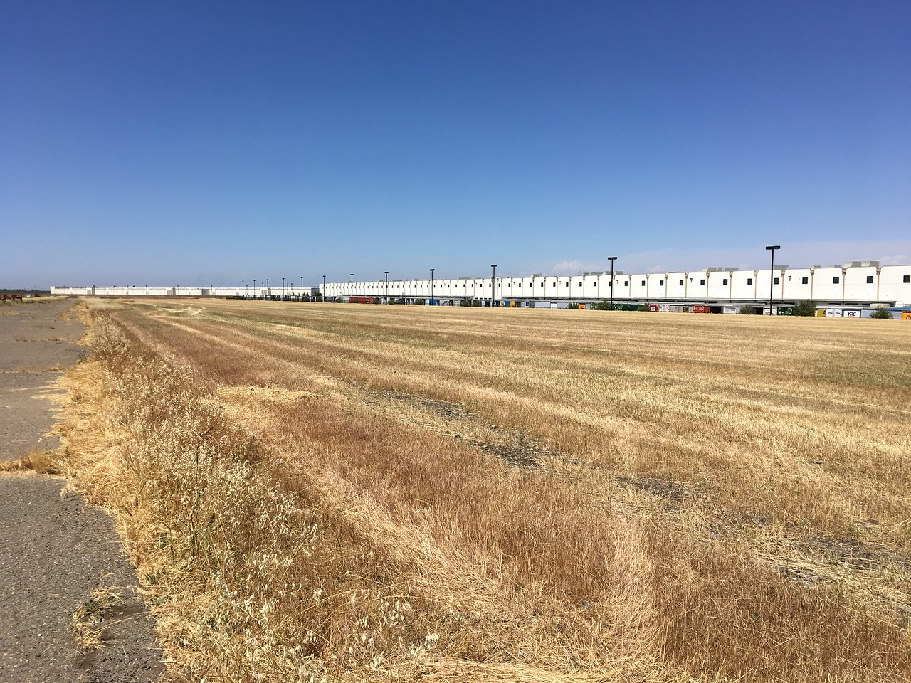 East Field next runway at Patterson.  Wide open the day we visited, but could quickly change.  Note Amazon warehouse.