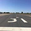 Runway at Turlock Airpark.  Excellent condition, but watch out for RC enthusiasts using the field.