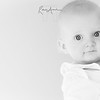 An inquisitive baby fixes me with those amazing eyes. Portraits of kids look so good if their eyes are sharp with lovely lights in them.