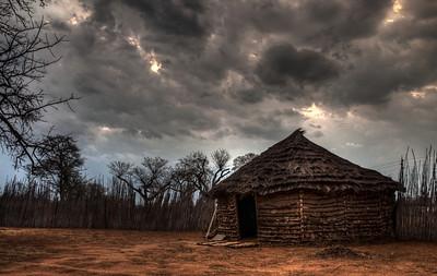 village-hut-clouds-1