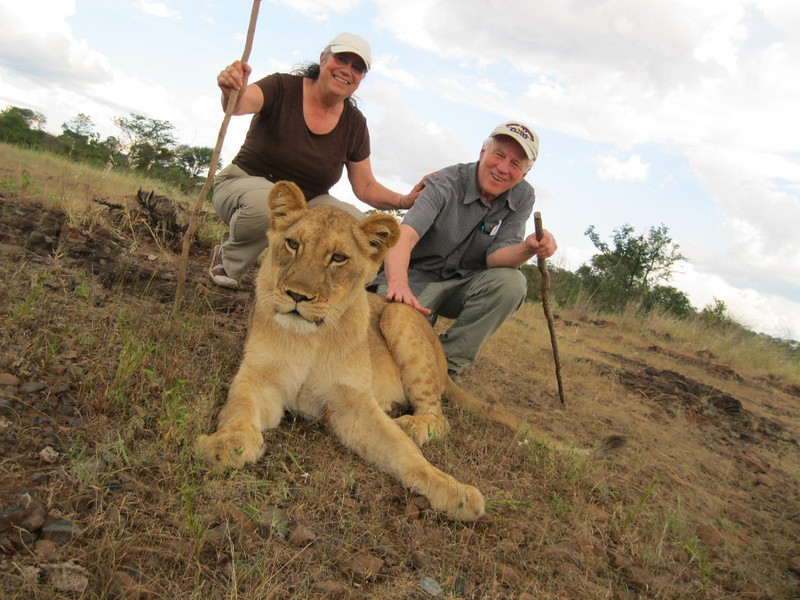 Terry and Gerry and 2-year old lion cub.