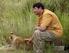 Marc with lion cub.