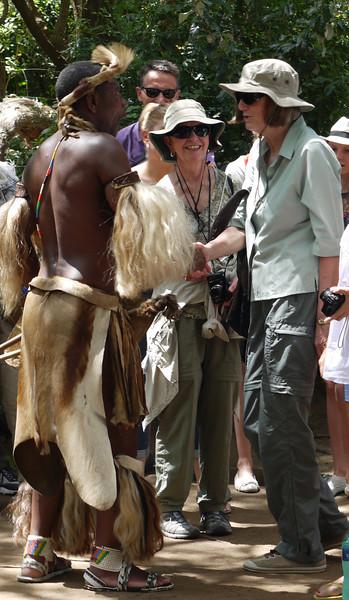 Judy meets the Zulu greeter at the Zulu Village