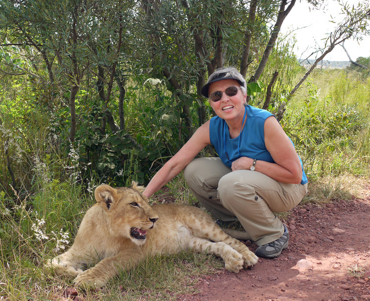 Susie can feel the panting and soft fur of a six-month old female lion.