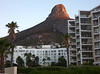 Lion's Head (mountain) and our hotel: Protea President (lower-rise building at left).  I am standing on the shoreline promenade for this photo.
