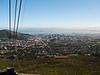 This is on the cablecar ride up Table Mountain, overlooking Cape Town.  The round car rotates so everyone gets a good view.  There is a tank of water suspended below, to supply the top of the mountain.  The wastewater is carried down in the same way, presumably in another tank.