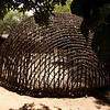 "These bent and interwoven reeds create the structure of the ""beehive"" huts."