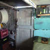 Inside a corrugated-metal house in Khayelitsha, proudly on display by its owner.
