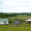 In the rural areas of South Africa and Swaziland, we saw compounds like these.  Modern square houses (to accommodate furniture?), plus rondavels used for storage and for the older women who suspect evil spirits live in corners.