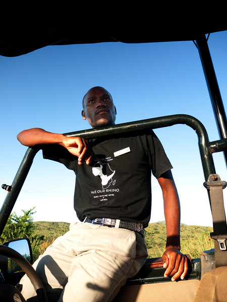 I wish I had bought one of those tee shirts, but they were too big.  This is Cela,  our morning guide at Hluhluwe Reserve.  He is delightful, but sorry we don't see many animals.