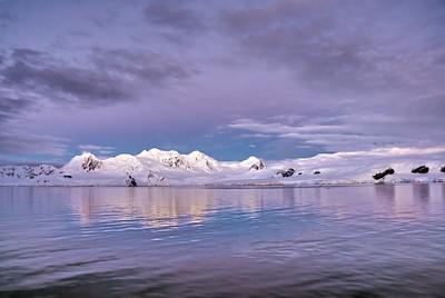 Antarctica dawn in still water