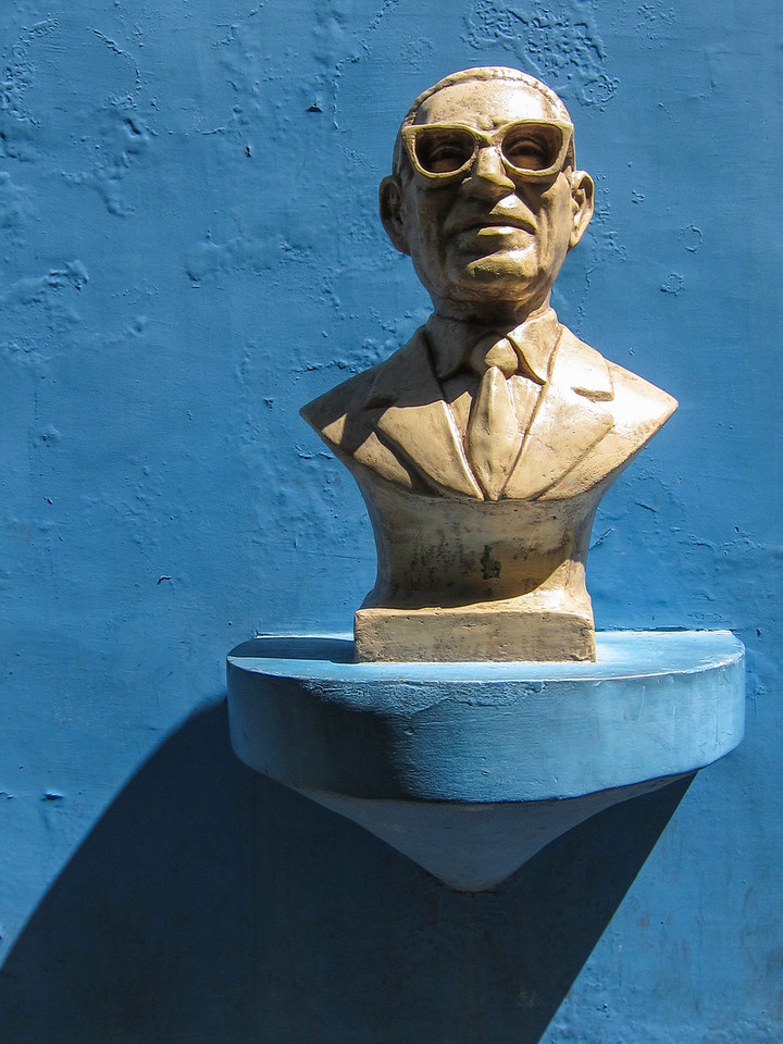 Bust of man with glasses.  Who is this guy?