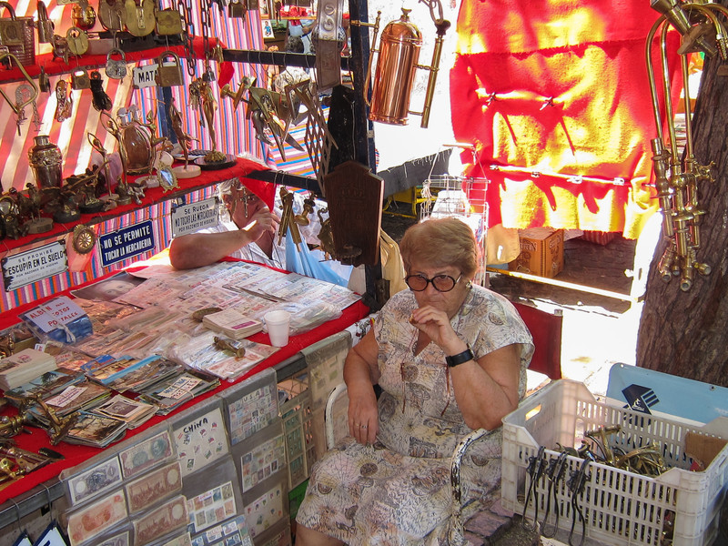 Lady selling items at the San Telmos Sunday Market.