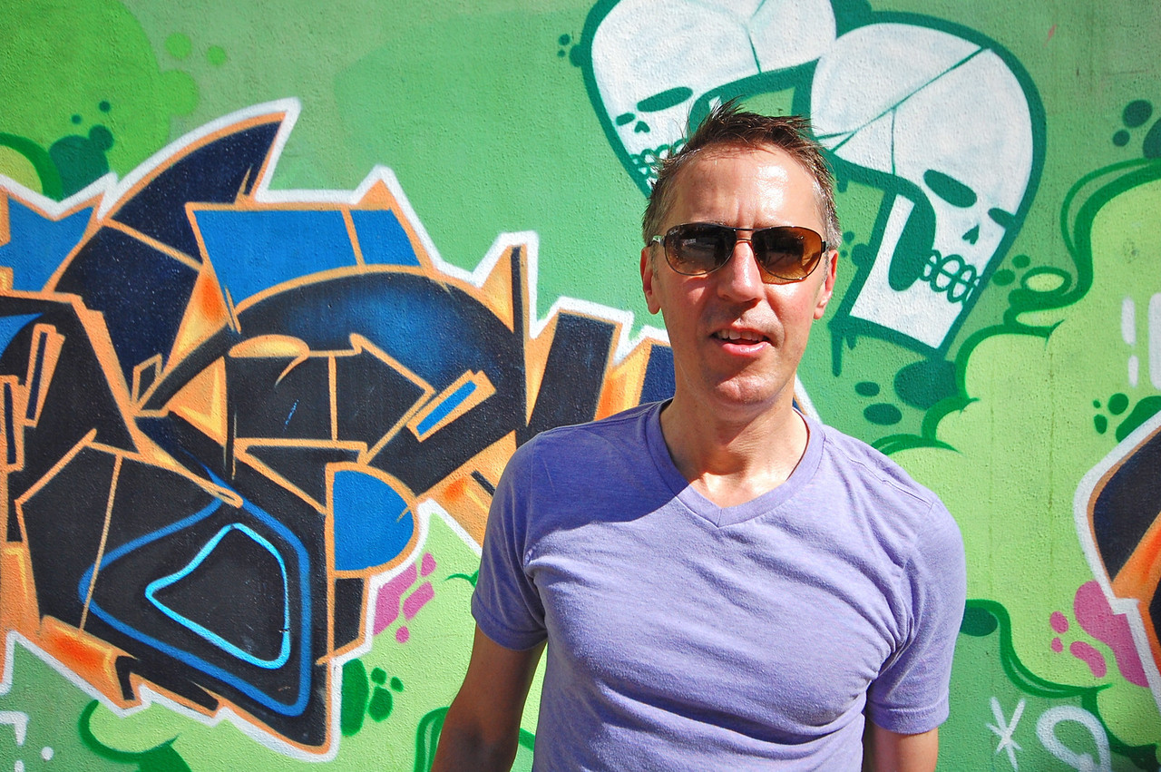 DSC_0013<br /> Tom in front of street art, Ipanema.