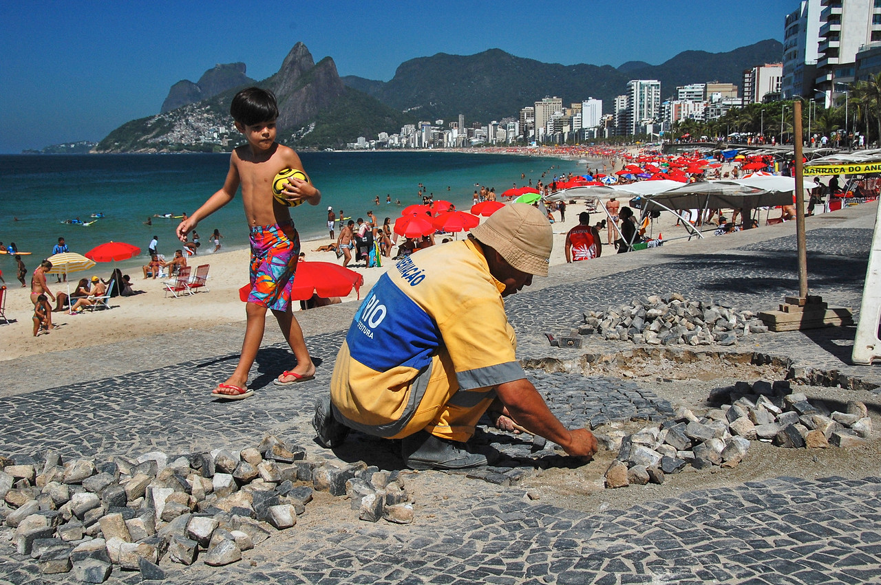 DSC_0183<br /> Man repairing the famous sidewalks in Ipanema.