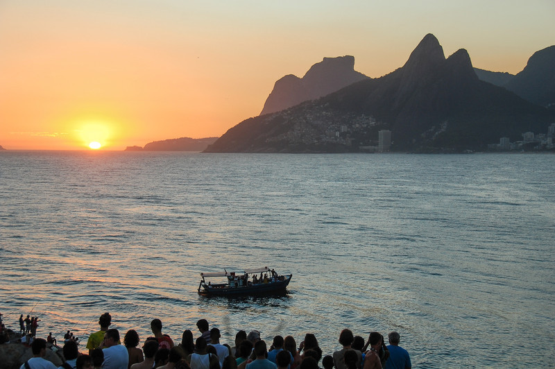 DSC_0449<br /> Every sunset is a reason to celebrate in Ipanema.  Everyone gathers on the Aproador rocks.