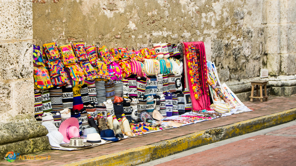 Colorful colonial Cartagena shown in its crafts available on city streets.