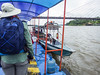 Boarding the motorized canoes