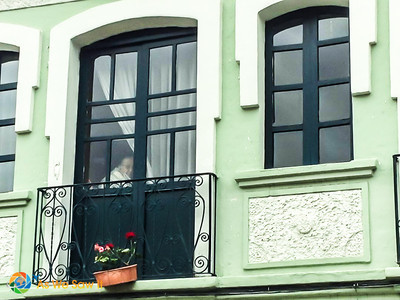 This lady enjoyed watching me take pictures of balconies from inside her Juliet balcony.