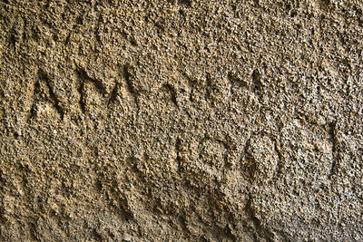 Carved name and date from early inhabitant of cave on Floreana Island.