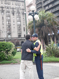 South Americans greet each other with a kiss on both cheeks, male or female.