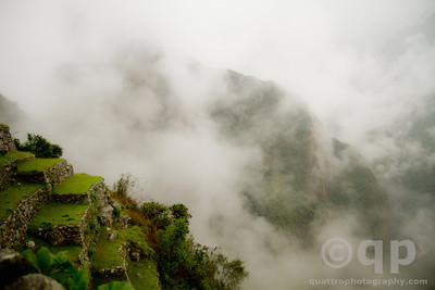 MACHU PICCHU TERRACE IN THE CLOUDS
