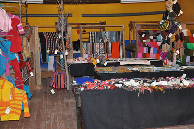 the mothers group works together twice a week to create crafts that are sold to tour groups and volunteers.  (Tallares)