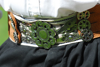 Gauchos wear a silver belt to hold up their pants (bombachas).   The belts are often decorated with silver and coins and are a status symbol with other gaucho and the girls.