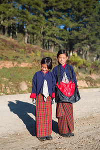 Students stop for a portrait on their way to school in the Phobjikha Valley