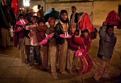 Young boys pose for the camera as part of the Mehndi procession arrives at the Baradari from the Karbala Mosque.