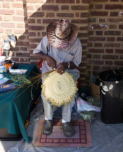 Sweet grass basket weaver at the Market in Charleston.
