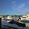 Boats docked at a marina on the intracoastal waterway in South Carolina with blue sky and marsh grass in the background.  Bluemoon1236 ,Bluemoon Fine Photography