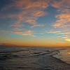 "Sunset over tidal waves with sun reflected in waves, clouds and sky.  bluemoon1236;  <a href=""http://www.bluemoon1236.smugmug.com"">http://www.bluemoon1236.smugmug.com</a> ,Bluemoon Fine Photography"