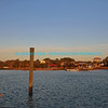 "Mooring post on side of intracoastal waterway in South Carolina with emerald blue water and bright blue sky with wispy white clouds in the background.<br /> <br /> bluemoon1236<br />  <a href=""http://www.bluemoon1236.smugmug.com"">http://www.bluemoon1236.smugmug.com</a> ,Bluemoon Fine Photography"