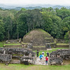 Tourists explore Mayan ruins, Caracol, Belize.