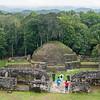 Tourists explore Mayan ruins, Caracol, Belize.