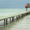Pier with thatched roof shelter, Sarteneja, Belize