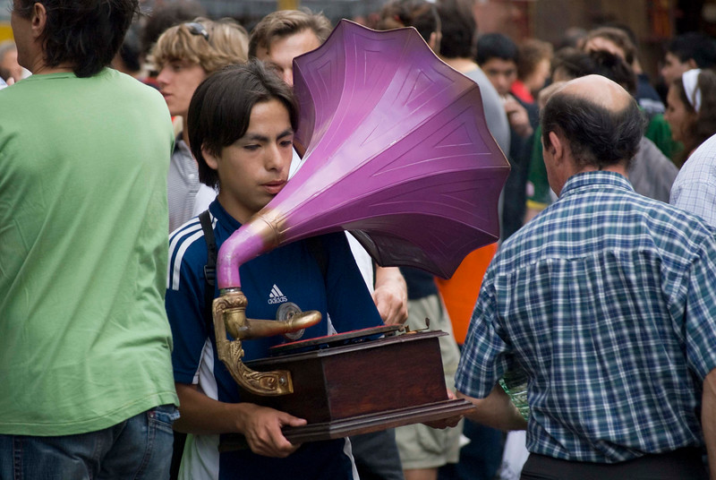 Young man with victrola at Sunday Feria de San Telmo, Buenos Aires, Argentina