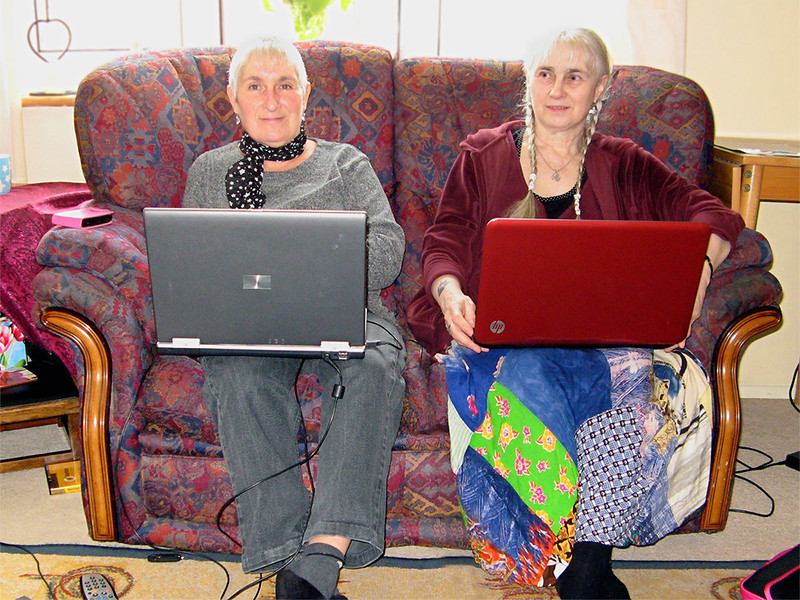 Cath and Joy in St Leonards-on-sea with Cath's old and new laptop. We spent an amazing amount of time like this! [<i>Composite image: right-hand half taken by Cath Allwood</i>]